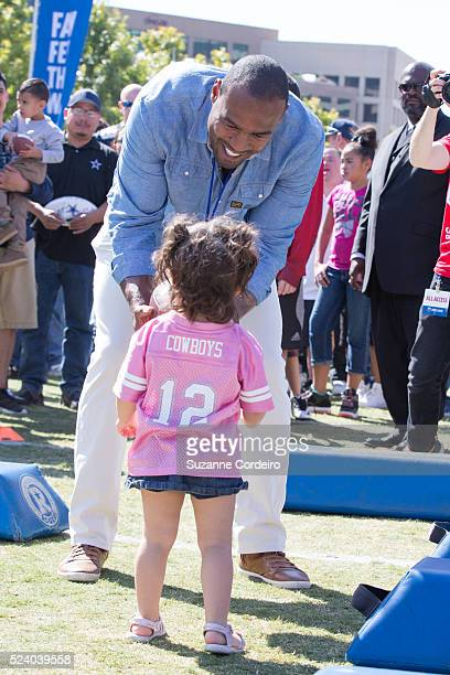 Cowboys Super Bowl champion Darren Woodson interacts with fans during at Carnival's Ultimate Cowboys Fan Fest on October 18 2015 at Klyde Warren Park...