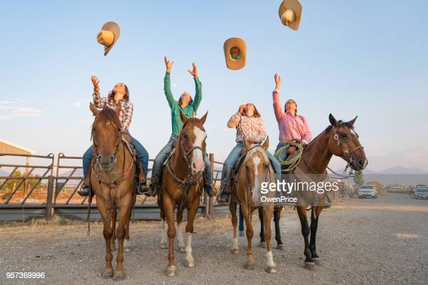 cowboys throwing hats into the air. - ranch stock pictures, royalty-free photos & images