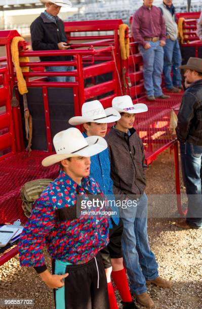 cowboys waiting for rodeo at paddock