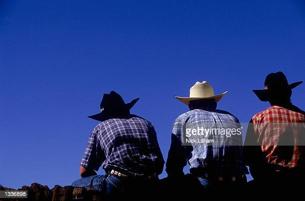 Cowboys watch an event during the Mount Isa Rodeo held in Mount Isa Australia on August 11 2002 The rodeo event held in the Australian outback town...