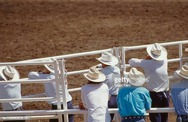cowboys watching calgary stampede - calgary stampede stock pictures, royalty-free photos & images