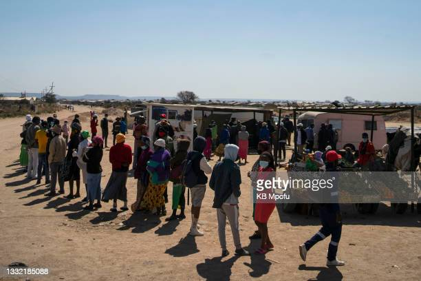 Cowdray Park residents wait patiently for their turn to get vaccinated against Covid-19 on August 3, 2021 in Bulawayo, Zimbabwe. Bulawayo's efforts...