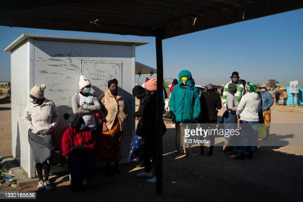 Cowdray Park residents wait to receive their Covid-19 vaccines from army officers on August 3, 2021 in Bulawayo, Zimbabwe. Bulawayo's efforts to...