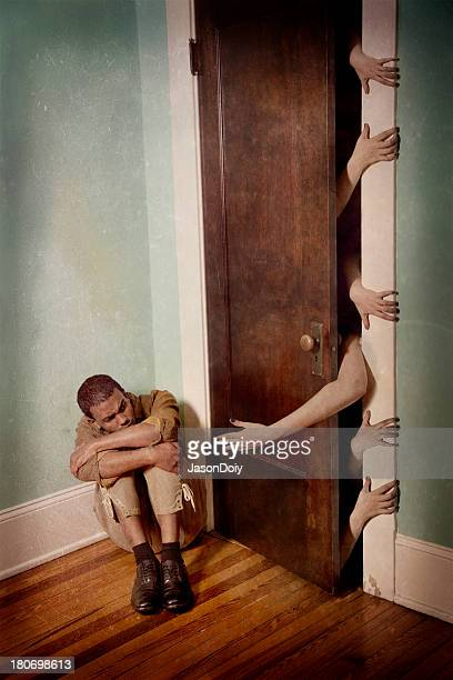 cowering in terror - magic doors stock pictures, royalty-free photos & images