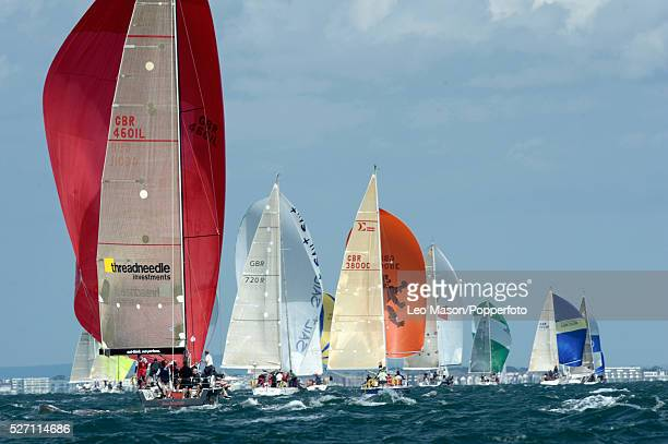 Cowes Week Cowes IoW UK Mixed class yachts on their spinnaker run