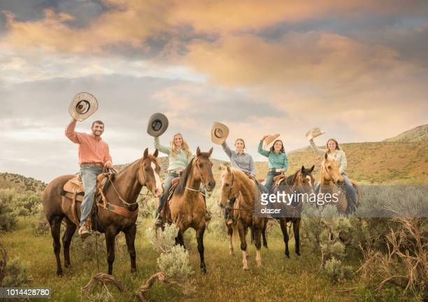 cowfamily, father, daughters on horses, fields and utah mountains - horseback riding stock pictures, royalty-free photos & images