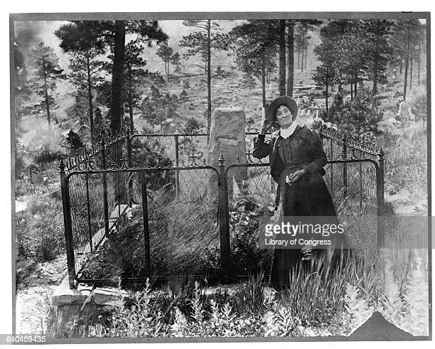 Cowgirl Calamity Jane at Wild Bill Hickock's grave a man she claimed was a lover at one point She would be buried next to him in 1903