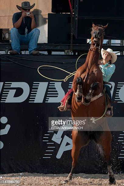 Cowgirl competes during the 6th Cowgirl World Championship in Villavicencio, Meta department, Colombia on March 18, 2012. Competitors from Colombia,...