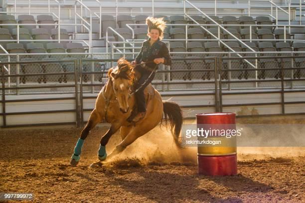 cowgirl cowboy riding horse at rodeo paddock arena at nephi of salt lake city slc utah usa - spanish fork utah stock pictures, royalty-free photos & images