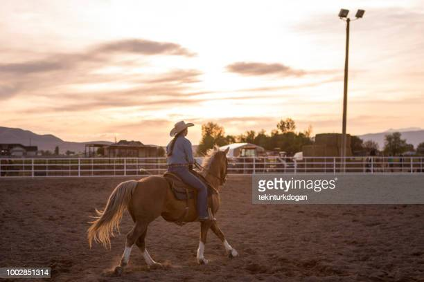 cowgirl cowboy riding horse  at rodeo paddock arena in spanish fork of salt lake city slc utah usa - spanish fork utah stock pictures, royalty-free photos & images