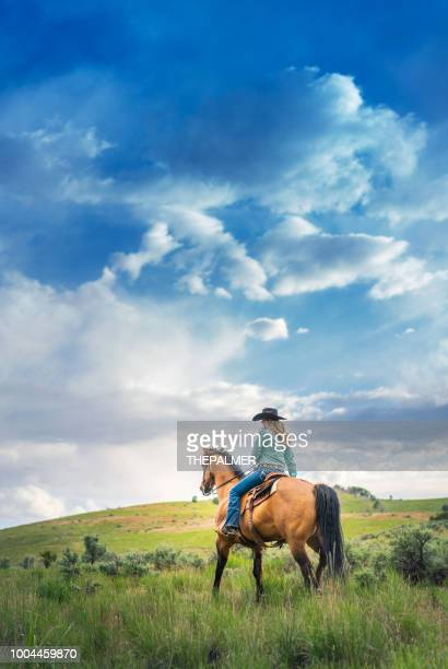 cowgirl horseback riding - prairie stock pictures, royalty-free photos & images