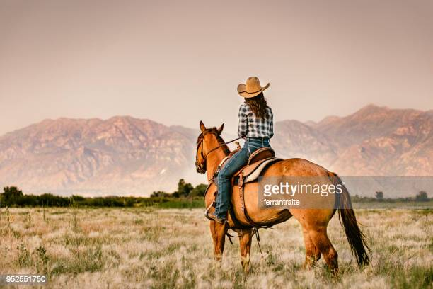 cowgirl horseback riding - wild west stock pictures, royalty-free photos & images