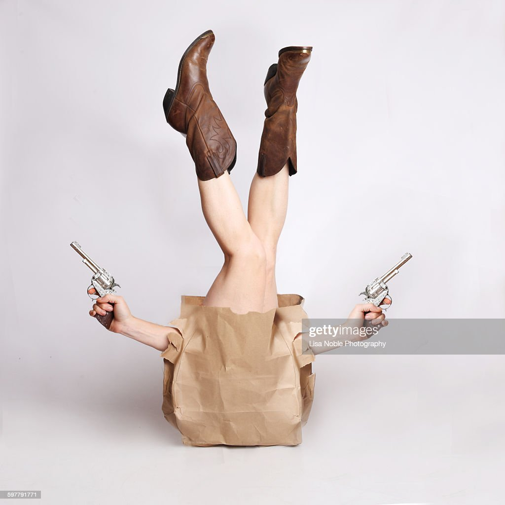 Cowgirl in a bag : Stock Photo