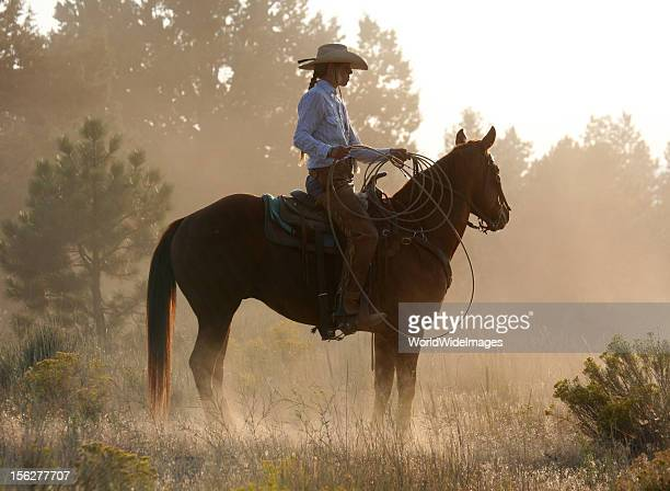 cowgirl on horse at dusk