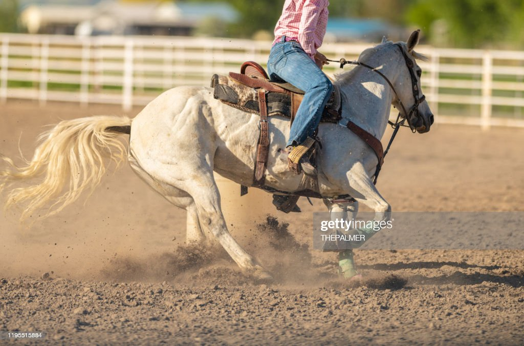 Cowgirl On Horse Barrel Racing Rodeo High Res Stock Photo Getty Images