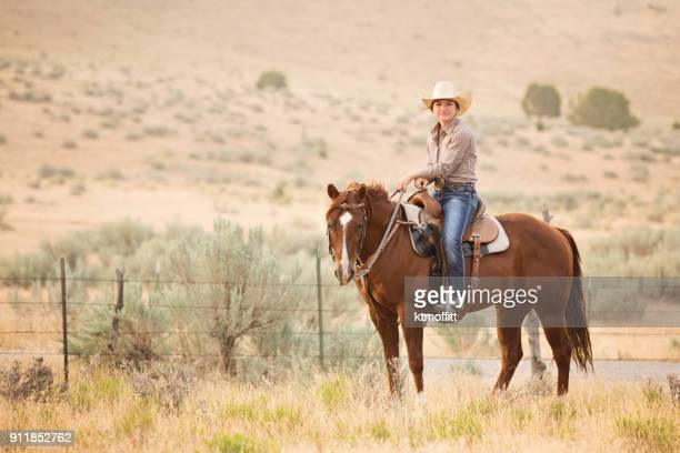 Cowgirl Riding Horse on Utah Ranch