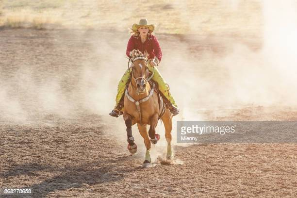 Cowgirl Speeding Barrel Racing Competition