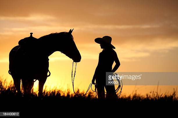 cowgirl walking her horse