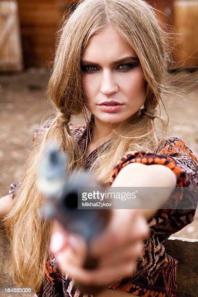 cowgirl with gun - cowgirl hairstyles stock photos and pictures