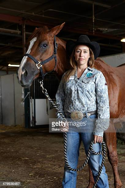 Cowgirl with Horse in Barn