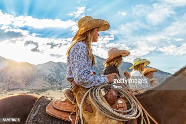 cowgirls and cowboy line up waiting to go for a ride in the morning - ranch stock pictures, royalty-free photos & images