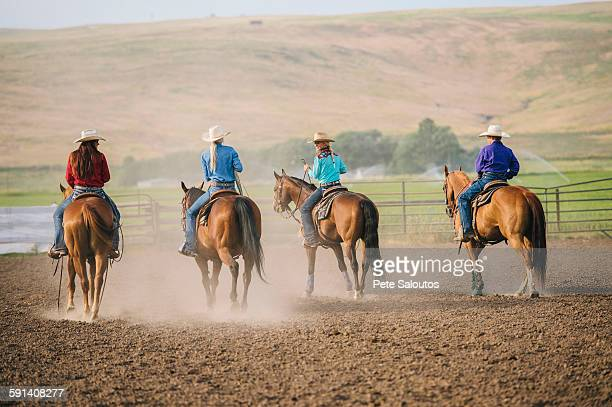 cowgirls and cowboy riding horses on ranch - cowgirl photos et images de collection