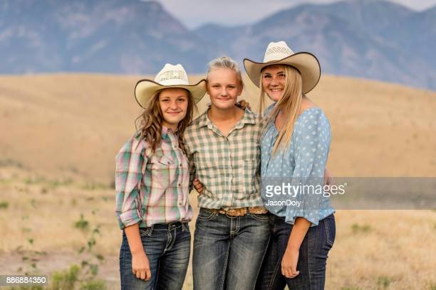 cowgirls dancing in the countryside - sagebrush stock pictures, royalty-free photos & images