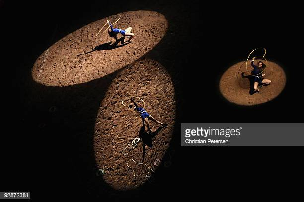 Cowgirls perform rope tricks at the World's Toughest Rodeo at Jobingcom Arena on November 6 2009 in Glendale Arizona