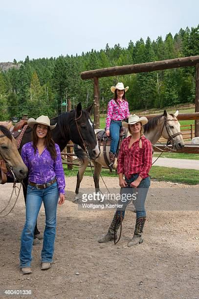 Cowgirls with their horses at Averill's Flathead Lake Lodge a dude ranch near Kalispell Montana United States