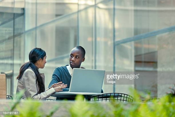 co-worker pitching an idea outside the office - leanintogether stock pictures, royalty-free photos & images