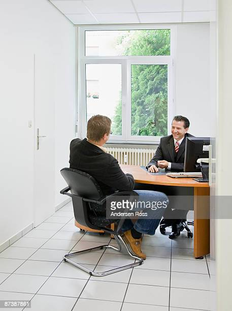 Co-workers at desk in office