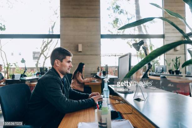 coworkers at office - economist stock pictures, royalty-free photos & images