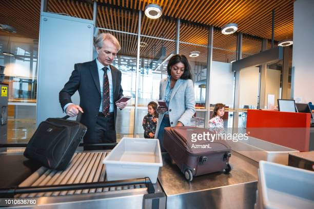 Coworkers at security counter in airport terminal