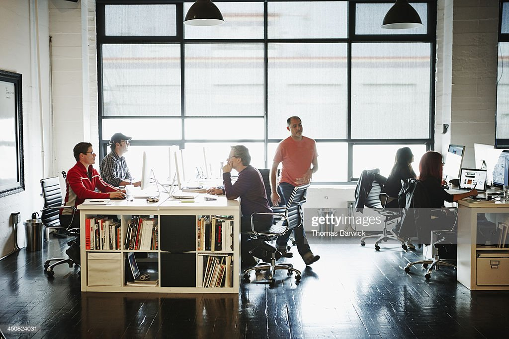 Coworkers at workstations in high tech office : Stock Photo