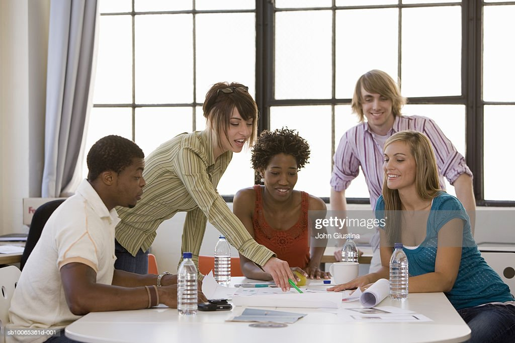 Co-workers brainstorming at meeting : Foto stock