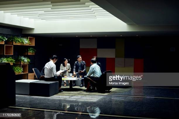 coworkers brainstorming during meeting in office - formal stock pictures, royalty-free photos & images