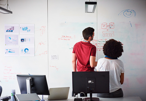 Coworkers brainstorming in a start-up office - gettyimageskorea