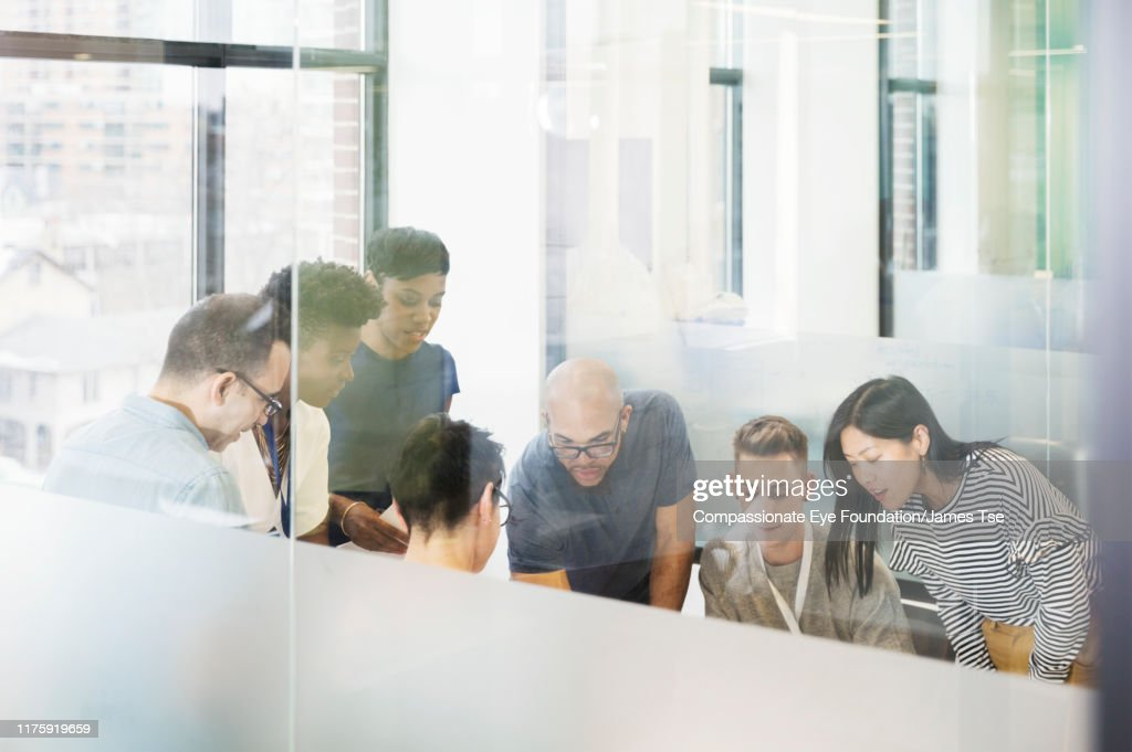 Co-workers brainstorming in modern office : Stock Photo