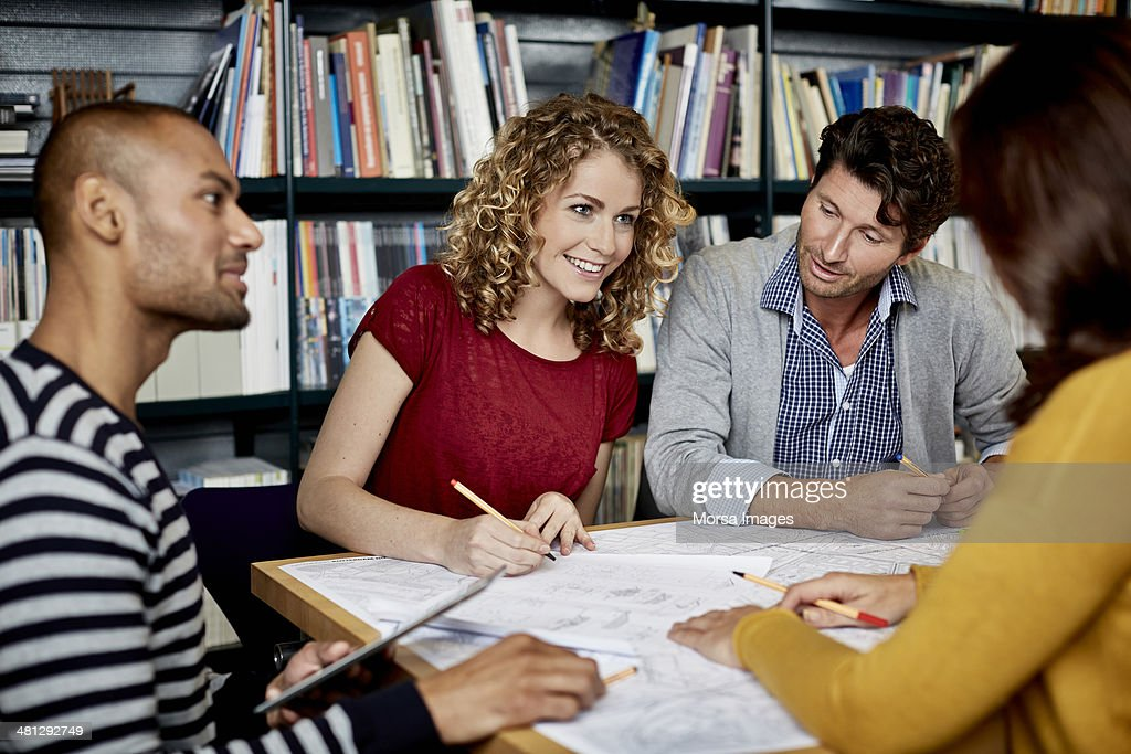 Coworkers discussing project details : Stock Photo