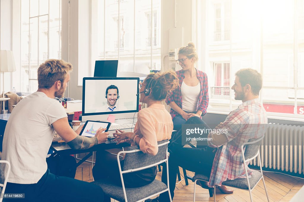 Coworkers doing a video conference in the conference room : Stock-Foto