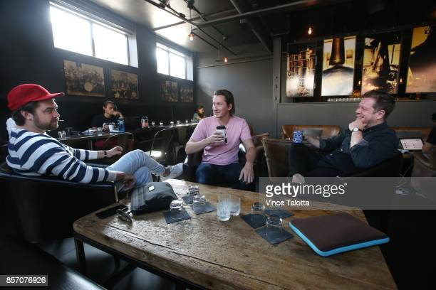 TORONTO ON SEPTEMBER 21 Coworkers from left to right Jon Friis Rob Domagala and Liam Thurston all from TWG discuss business on Flexday being held at...