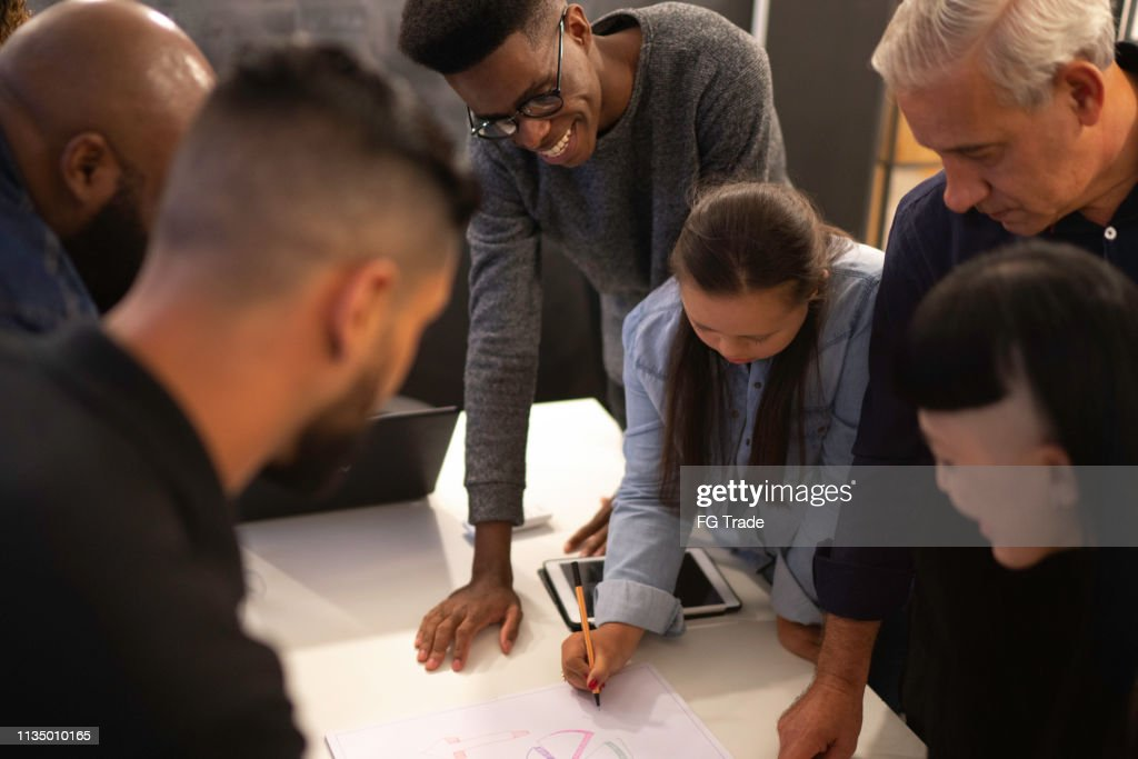 Coworkers having a constructive meeting in the office : Stock Photo