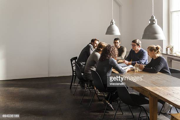 Coworkers having a meeting in modern office