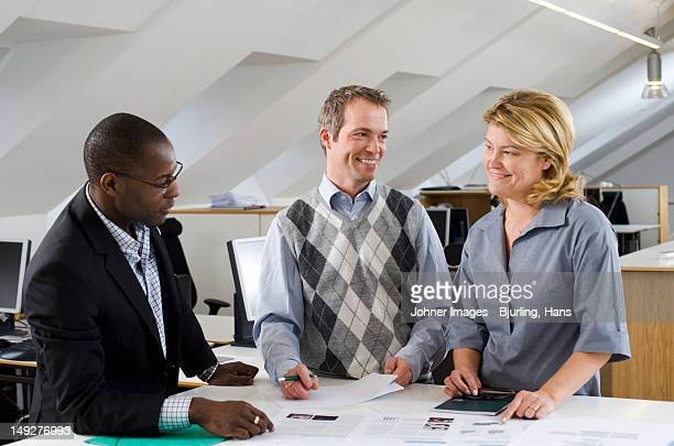 Coworkers having discussion in office