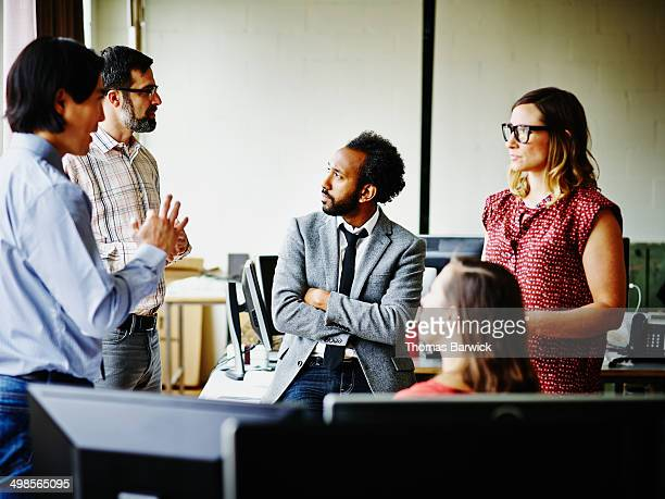 Coworkers having informal meeting in office
