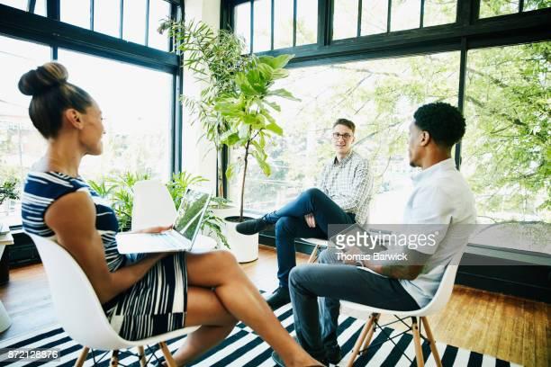 Coworkers having informal meeting in start up office