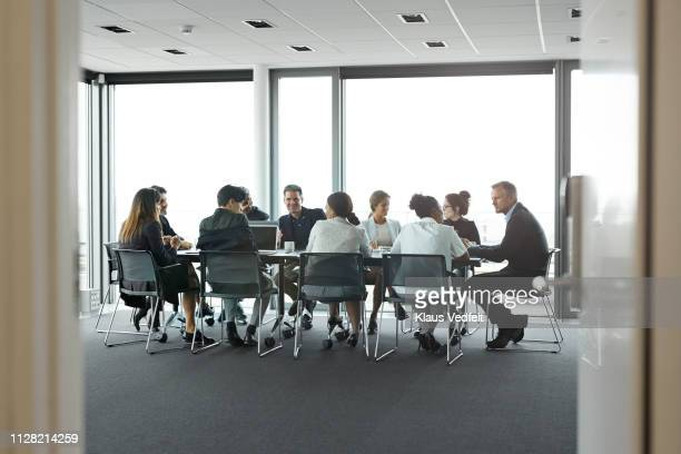 co-workers having meeting with laptop in conference room - board room stock pictures, royalty-free photos & images