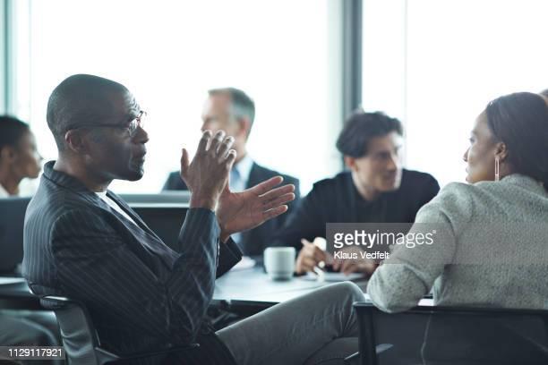 co-workers having meeting with laptop in conference room - finanzwirtschaft und industrie stock-fotos und bilder