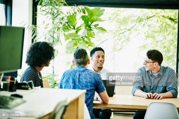 Coworkers having planning meeting at office conference table