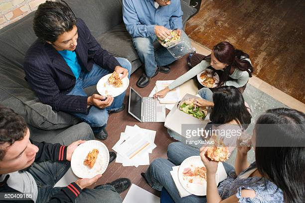 Co-workers having working lunch, high angle view